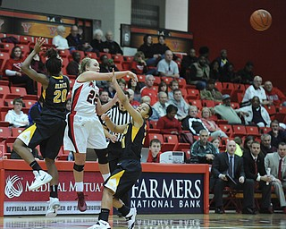Youngstown State #22 Ashley Lawson throws the ball to a teammate while attempting to avoid the pressure from VCU defenders #20 Adaeze Alaeze and ##21 Ashlee Mitchell during the first half of Saturday afternoons game.