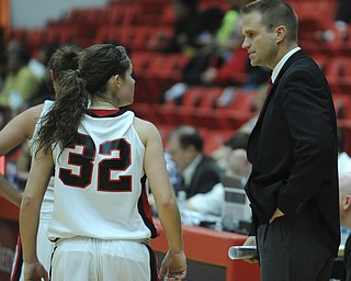 Youngstown State head coach John Barnes talks to Jenna Hirsch during a YSU free throw attempt during the first half of Saturday afternoons game.