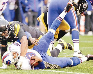 The Steelers' Cameron Heyward sacks Bills quarterback EJ Manuel during Sunday's game in Pittsburgh. The Steelers took down the Bills, 23-10.