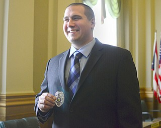 Jeffrey Kay of Howland sports his badge after he was sworn in as an officer with the Youngstown Police Department. The department welcomed four new officers at a ceremony in city council chambers Thursday.