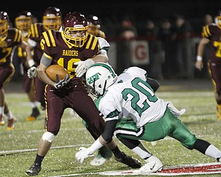 .          ROBERT  K. YOSAY | THE VINDICATOR..South Range #16 Zach Thorpe meets Mogadore #20  Alec Tarter as he is brought down during first quarter action and a 6 yard gain..South Range and Mogadore in Minerva Ohio .....-30-