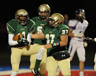 St. Vincent - St. Mary #4 Jarel Woolridge celebrates with teammate #37 Joe Faetanini and #51 Alec Bianci after scoring a touchdown on the first series of the game during Friday nights game in Ravenna. Poland #11 Dylan Garver pictured.