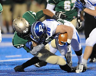 Poland #20 Ross Gould is tackled and dragged down to the ground by St. Vincent - St. Mary #47 Dante Booker during Friday nights game in Ravenna.