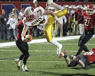 William D Lewis The Vindicator Mooney's Jon Saadey(16) cartwheels into the end zone for 1rst qtr TD against Struthers during playoff action Friday in Niles.