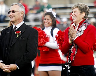 MADELYN P. HASTINGS | THE VINDICATOR..Ellen Tressel claps for her husband Jim after being inducted into YSU's Hall of Fame at half time of the YSU vs. NDSU game at Stambaugh Stadium on November 16, 2013.... - -30-..