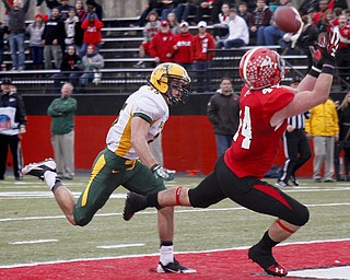 MADELYN P. HASTINGS | THE VINDICATOR..YSU's Nate Adams (44) catches the ball and scores a touchdown while NDSU's Christian Dudzik (35) follows behind during their game at Stambaugh Stadium on November 16, 2013. The Penguins lost to Bisons 17-35..... - -30-..
