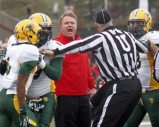 MADELYN P. HASTINGS | THE VINDICATOR..YSU's head coach Eric Wolford yells at a referee during their game against NDSU at Stambaugh Stadium on November 16, 2013. The Penguins lost to Bisons 17-35... - -30-..