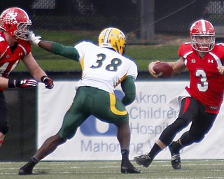 MADELYN P. HASTINGS | THE VINDICATOR..YSU's Dante Nania (3) runs with the ball from NDSU's Carlton Littlejohn (38) during their game at Stambaugh Stadium on November 16, 2013. The Penguins lost to Bisons 17-35..... - -30-..