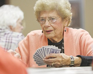 Jean Orin participates in Hand and Foot Game Night, playing a game that many players compare to canasta.
