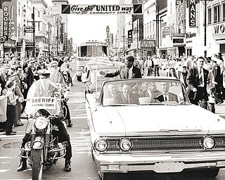 Several thousand persons lined W. Federal St. and Central Square in Youngstown on October 9, 1960, to greet the Democratic candidate as he arrived downtown. Photo taken by Youngstown Vindicator Photographer Paul Schell looking west on Federal St. from the intersection of Phelps.