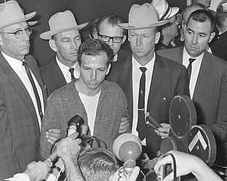 "Lee Harvey Oswald is shown early Nov. 23, 1963, as he stood before newsmen in a Dallas police station where he repeatedly denied that he had assassinated President Kennedy yesterday.  ""I did not kill President Kennedy,"" he said. ""I did not kill anyone. I don't know what this is all about."" He was brought before the newsmen just after formal charges of murder were filed against him."