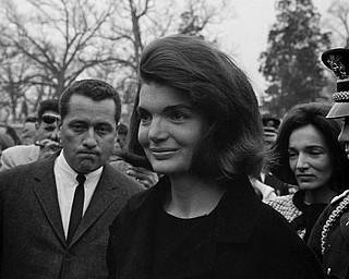 Jacqueline Kennedy manages a faint smile as she stands in Arlington National Cemetery near the grave of the assassinated president, Nov. 28, 1963.   (AP Photo/Bob Schutz)