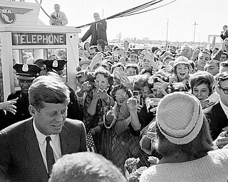 President John F. Kennedy and his wife Jacqueline Kennedy are greeted by an enthusiastic crowd as they arrive at Dallas Love Field,  November 22, 1963. Only a few hours later the president was assassinated while riding in an open-top limousine through the city.