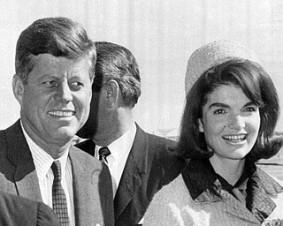 President John F. Kennedy and his wife Jacqueline arrive at Dallas Love Field, Nov. 22, 1963, the day he was assassinated.