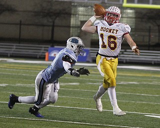.          ROBERT  K. YOSAY | THE VINDICATOR..Mooneys QB  Jon Saadey goes airborne to get off a first down pass during second quarter action as chasing him is #4 Benedictines Jerome Baker..Cardinal Mooney Cardinals vs Cleveland Benedictine Bengals in Solon.....-30-