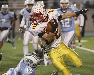 .          ROBERT  K. YOSAY | THE VINDICATOR..#22 Mooney's  Mark Handel Makes a cut  around Benedictines #12   Dom Berdysz  to get a first down during second quarter action..Cardinal Mooney Cardinals vs Cleveland Benedictine Bengals in Solon.....-30-