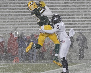 .          ROBERT  K. YOSAY | THE VINDICATOR..In blinding Snow   Fitchs #6 Rodney Smith brings down #18  St Eds David Dowell after receiving  a first down pass during second quarter action ..Austintown Fitch and St Edwards at Infocision in Akron.....-30-