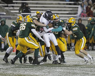.          ROBERT  K. YOSAY | THE VINDICATOR..Fitchs #9 Joey Harrington is gang tackled as he gets barely a yard ..Austintown Fitch and St Edwards at Infocision in Akron.....-30-