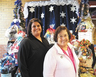 SPECIAL TO THE VINDICATOR: Preparations are being made for the Ursuline Preschool and Kindergarten's 25th annual Once Upon a Christmas craft show Dec. 7. Above are craft show chairwoman Christy Durham, left, and Sister Charlotte Italiano, school principal.