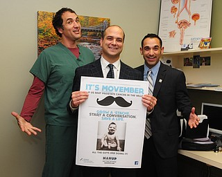Surgical assistant Andrew Labedz, left, Dr. Dan Ricchiuti, and Jonathon Fauvie celebrated the beginning of Movember at the Boardman office of NEO Urology.