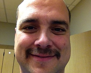 Dr. Dan Ricchiuti M.D., a urologist and surgeon, showed off how his mustache was progressing mid-way through Movember.