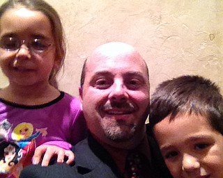Dr. Vince Ricchiuti M.D., a urlologist and surgeon, showed off his Movember progress while spending some time with his children.