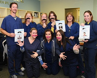 The staff at NEO Urology in Boardman displayed their Movember spirit. Employees include, front from left, Emily Baluch, Carley Michaels, Jessica Kucek, and back row, Raymond Lillo, Shirley Nemec, Sandy Smith, Jane Rosinski, Lori Fitch and Nicole Krut-Heim. Lillo participated in the Movember event with a mustache.