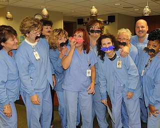 Nurses in the same-day surgery unit at St. Elizabeth Hospital joined in Movember fun. They include, from left, Becky Rainey, Michelle McBride, Cathy Chambers, Diane Brenner, Mary Ann Smith, Emilie Doneyko, Gail Conrieote, Debbie Ferrell, Ratico Pusic and Marva Jones.