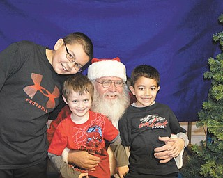December 2012, at the Plumbers and Steamfitters Local 396 children's Christmas Party, Renee Bero took a picture of her younger grandsons with Santa, Santino Jorge of Struthers, Noah Troggio of New Middletown, Santa (Lonnie Potts) of the North Pole; and Alex Jorge of Struthers.