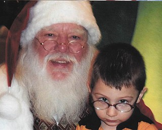Alex Simon from Poland was 2 when he was brave enough to sit on Santa's lap in 2010 at Southern Park Mall. Sent by great-grandma Nancy Ray.