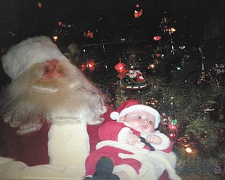 Marian Beil sent a picture of her grandson Jakoby with Santa, his first Christmas two years ago. It was taken at their annual family Christmas party. We make sure Santa is there every year. There are many little ones so we have a great time.