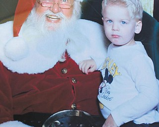 This is this year with Santa. Brady Ford Hodge, grandson of Ron and Cathy Hinderliter of Canfield. (Crying picture was last year; both taken in Fontana, Calif.)