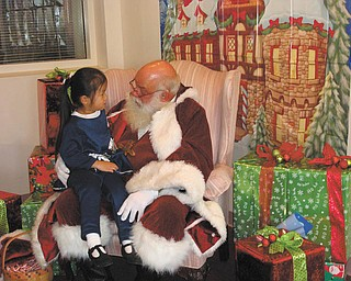 Jenni-Lin of Canfield was having a serious conversation with Santa. The picture was taken in 2011 while attending preschool at Canfield Methodist Church. Submitted by her grandmother Norma Remias.