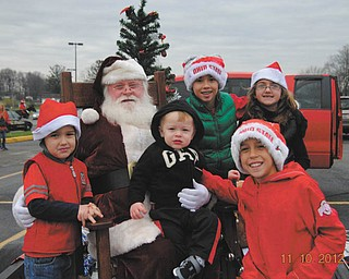 Grandma Peggy Jones took this picture last year during the Springfield Chamber of Commerce Parade of her 5 grandchildren, Morgan and Mason Santangelo and Mariah, Dominick and Caden Jones, all of Springfield Township.