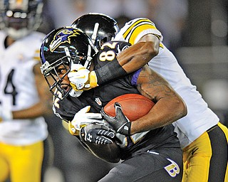Baltimore Ravens wide receiver Torrey Smith (82) is tackled by Pittsburgh Steelers cornerback Cortez Allen after making a catch in the first half Thursday night in Baltimore. The Ravens won 22-20.