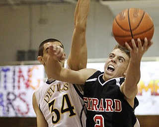 William D Lewis The Vindicator Girard's Jimmy Standohar(2) goes for 2 past Ken Greaver )34) of McDonald during Friday action at McDonald.