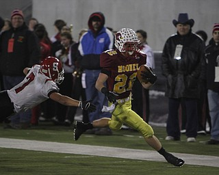 Cardinal Mooney's Mark Handel (22) eludes a tackle by Steubenville's Bryan Pierro (7) during the second quarter of Friday nights Division four Semi-Finals matchup at Fawcett Stadium in Canton.  Dustin Livesay  |  The Vindicator  11/29/13  Fawcett Stadium, Canton.