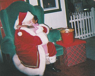 Santa gets a hug from Leilani Pete, age 5. Sent by grandmother Othella May.