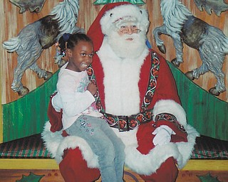 Leilana Pete, 7, visited with Santa at Macy's in New York. Sent by grandmother Othella May.