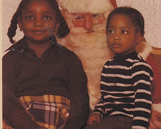 Sisters Carol and Nechelle Thomas are sitting on Santa's lap. Sent by Aunt Othella May.