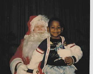 Michael Pete was 4 at the time of this visit with Santa. Sent by his mom, Othella May.