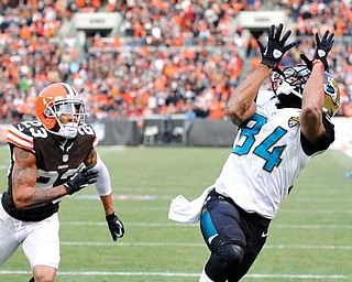 Jacksonville Jaguars wide receiver Cecil Shorts (84) catches a 20-yard touchdown pass against Cleveland Browns cornerback Joe Haden (23) in the fourth quarter of a game Sunday in Cleveland. The score gave the Jaguars a 32-28 win over the Browns.