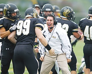 Cardinal Mooney High graduate Frank Colaprete, center, is the head coach for the College of Wooster. This season, the Fighting Scots went 7-3.