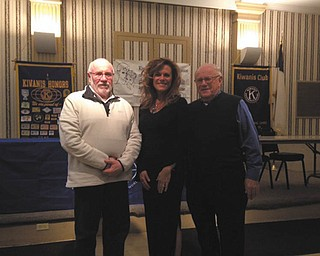 SPECIAL TO THE VINDICATOR The Downtown Kiwanis Club met Nov. 15 and learned about the No Stone Unturned Foundation, established by the speaker and her husband. Dr. Melinda Wolford and Eric Wolford, Youngstown State University football coach, started the foundation after their son, Stone, was diagnosed at age 2 with cardio-facio-cutaneous syndrome, a rare genetic disorder. The foundation provides support for patients and families touched by CFC and other debilitating illnesses, raises awareness by providing information, and promotes aggressive research on ways to enhance their lives. For information visit www.nostonefoundation.org. Above from left are Gary Winslow, Kiwanis Club immediate past president; Dr. Wolford; and Chuck Whitman, the club's program sponsor.