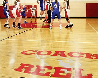 The basketball court at Canfield Village Middle School is dedicated to Ken Reel, a longtime teacher and coach who died of cancer in June. A game between the Canfield and Hubbard girls teams tipped off after Tuesday's ceremony.