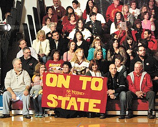 Families and friends cheer on the Cardinal Mooney Cardinals at a pep rally Thursday at the high school. The school sent the team off this morning to play in the Division IV championship game against Clinton-Massie at 3 p.m. in Massillon.
