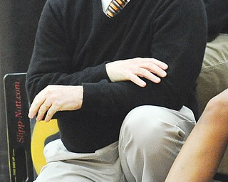 Howland head coach John Diehl watches from the bench during Thursday's game against Warren Harding at Howland. The Tigers downed the Raiders, 53-43, to earn Diehl his 400th career win.