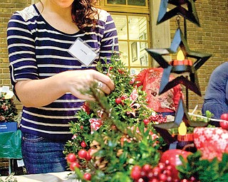 Lisa Dory of Greenford decorates a Boxwood tree at the Butler show, which took place Saturday and Sunday. The trees are made from clippings from South Carolina and last an average of eight weeks.
