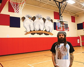 Aaron Chine, owner of Chinebox Ink on Mahoning Avenue, is the painter of murals at the Austintown schools. The murals depict falcons in various stages at each of the district's four schools. Chine, a Fitch High graduate, says he has always been into art and works with all forms.