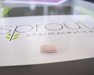 A tablet of flibanserin sits on a brochure for Sprout Pharmaceuticals in the company's Raleigh, N.C., headquarters. Sprout Pharmaceuticals said Wednesday that it has reached an impasse with the Food and Drug Administration over flibanserin.